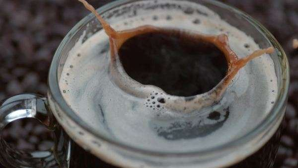 Sugar cubes splashing into coffee in slow motion Royalty-free stock video