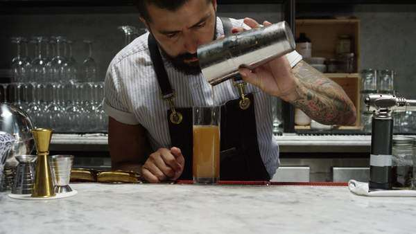 Medium shot of bartender preparing a cocktail Royalty-free stock video