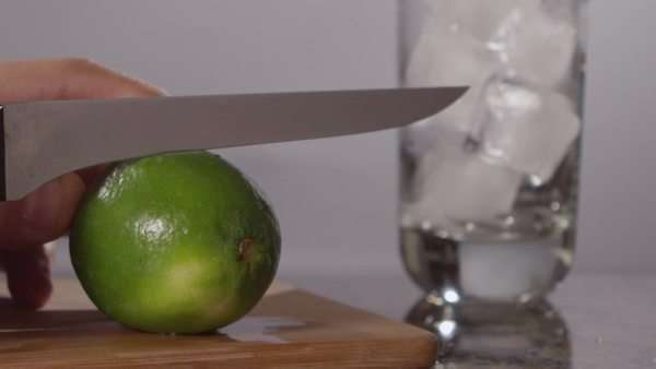 Close-up shot of a hand cutting a lime Royalty-free stock video