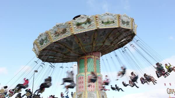 Flying chair ride at amusement park Royalty-free stock video