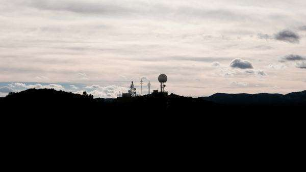 Profile timelapse of Radar and antennas over mountain, high contrast Royalty-free stock video