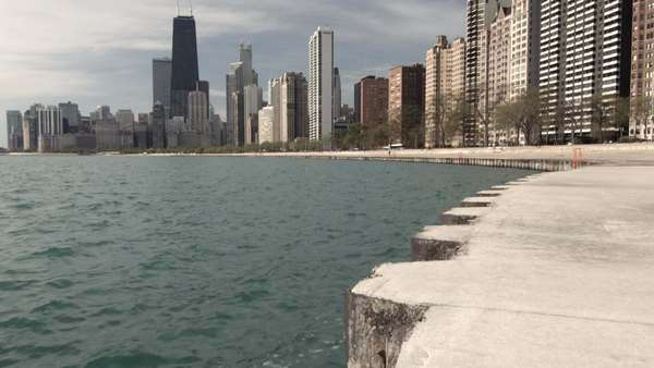 Tilt up to a view of the north side of Chicago, Illinois, USA, on Lake Michigan. 4K, Ultra High Definition. Royalty-free stock video