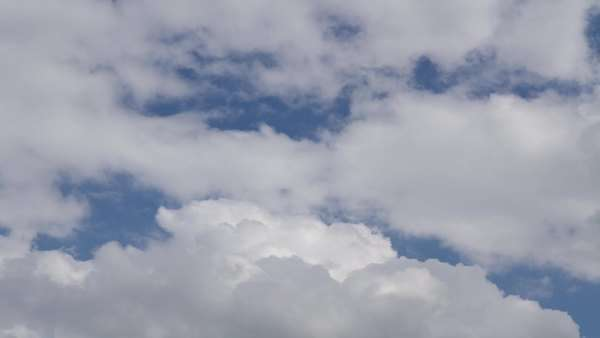 Clouds Form And Dissolve Against A Blue Sky. Timelapse Recording. Ultra  High Definition,