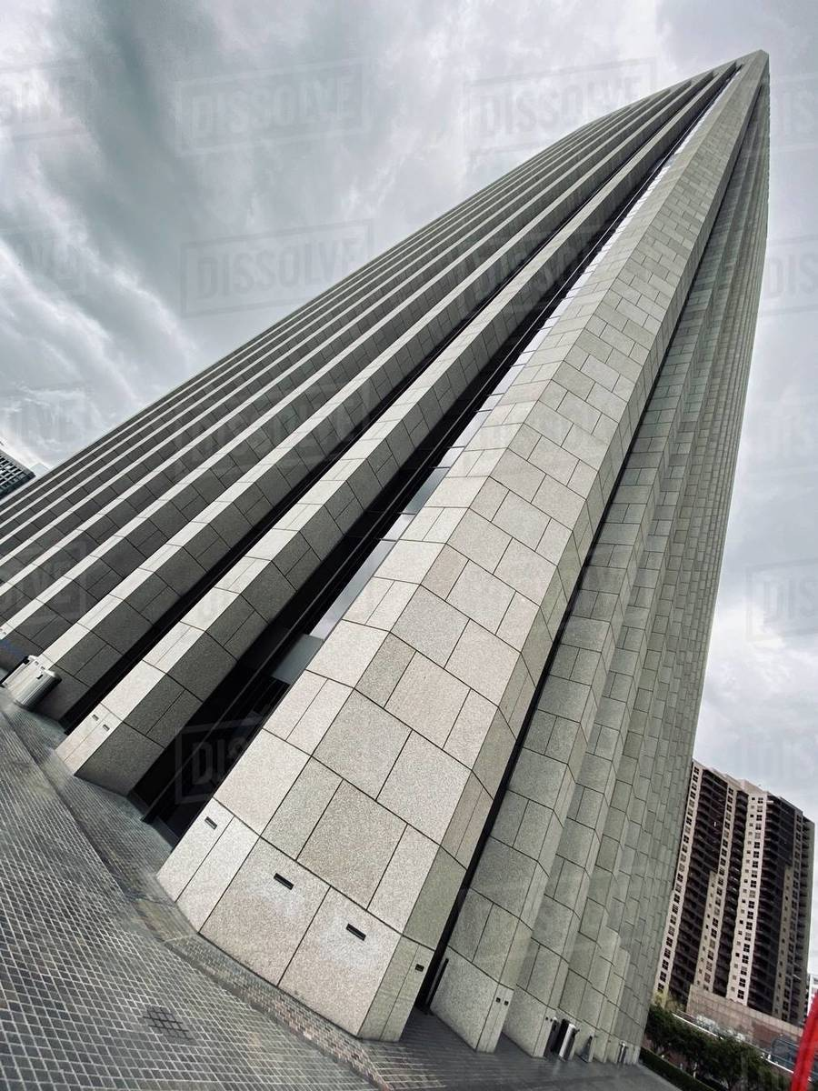 LOS ANGELES, CA, MAR 2020: strong angle, looking up at Bank of America skyscraper on overcast day in Downtown Royalty-free stock photo