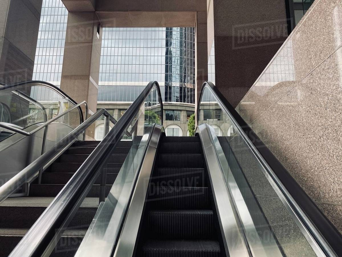 LOS ANGELES, CA, MAR 2020: escalators leading to base of office building, skyscraper at California Plaza in Downtown Royalty-free stock photo