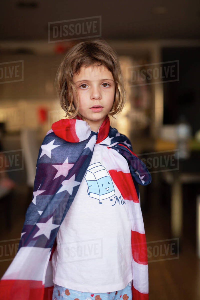 Girl looking at camera covered with an American flag Royalty-free stock photo