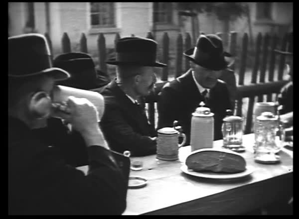 Group of men talking and drinking beers in early 1900s Royalty-free stock video