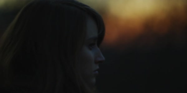 Hand-held profile shot of a pensive woman outdoors at sunset Royalty-free stock video