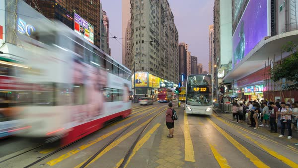 Time lapse of pedestrians and traffic at a busy road crossing in Causeway Bay, Hong Kong Island, Hong Kong, China Royalty-free stock video