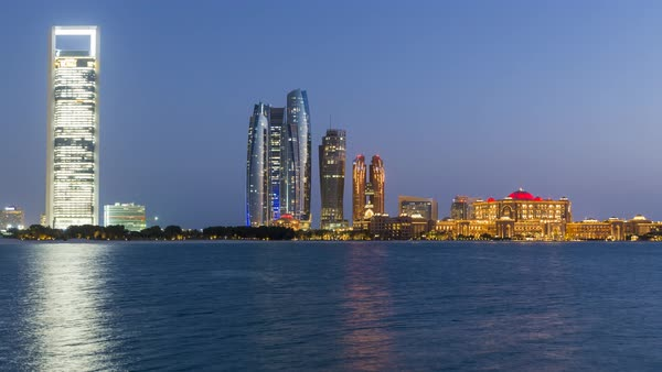 Etihad Towers and Emirates Palace hotel time lapse viewed from the Breakwater, Abu Dhabi, United Arab Emirates, Middle East Royalty-free stock video