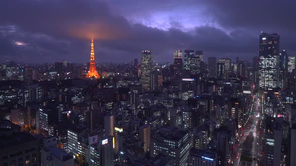 Japan, Tokyo, elevated night view of the city skyline and iconic illuminated Tokyo Tower  Royalty-free stock video