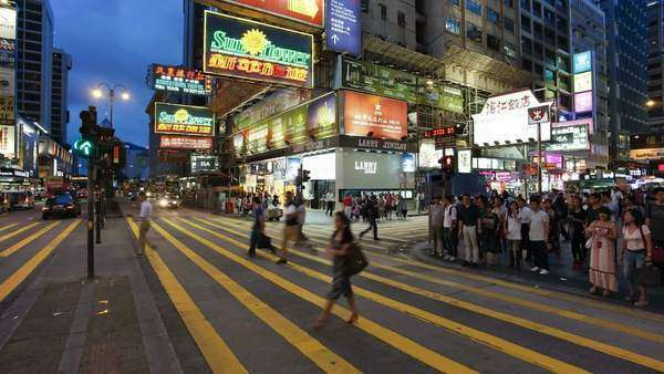 Busy Pedestrian crossing on Nathan Road, Kowloon, Hong Kong, China, Timelapse Royalty-free stock video