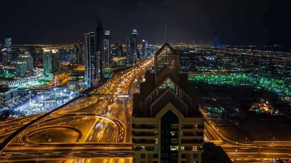 Elevated view over Sheikh Zayed Road and Financial Centre Road Interchange, Downtown Dubai, Dubai, UAE - timelapse Royalty-free stock video