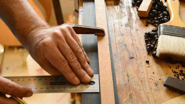 Detail of luthier making a classical guitar in workshop Royalty-free stock video