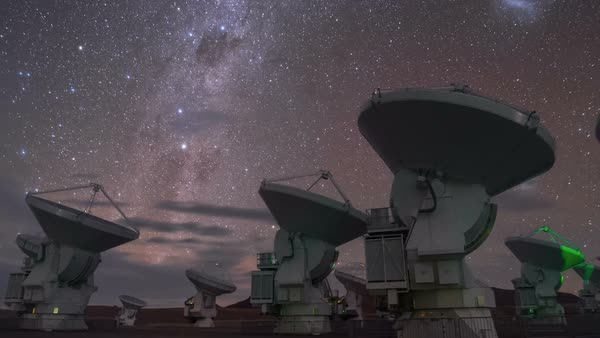 ALMA radio telescopes. Time-lapse footage of the Milky Way and other objects in the sky over the Atacama Large Millimeter Array (ALMA) radio telescopes in the Atacama Desert, Chile. Rights-managed stock video