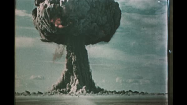 1950s Soviet atom bomb test and effects. Footage of the detonation of atomic bombs, and the resulting effects, during Soviet nuclear tests in the 1950s at the Semipalatinsk Test Site in what is now Kazakhstan. This footage shows the initial detonations, fireballs and shockwaves and the formation of the characteristic mushroom clouds. The footage also shows trees, military vehicles and equipment, buildings and other ground structures being destroyed by the effects of the atom bombs. Soldiers are seen taking shelter in a trench. A total of 456 nuclear tests were conducted at the Semipalatinsk site between 1949 and 1989. Rights-managed stock video