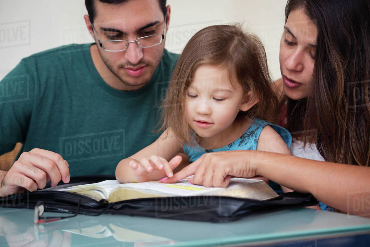 Young family studying the Word of God  Royalty-free stock photo