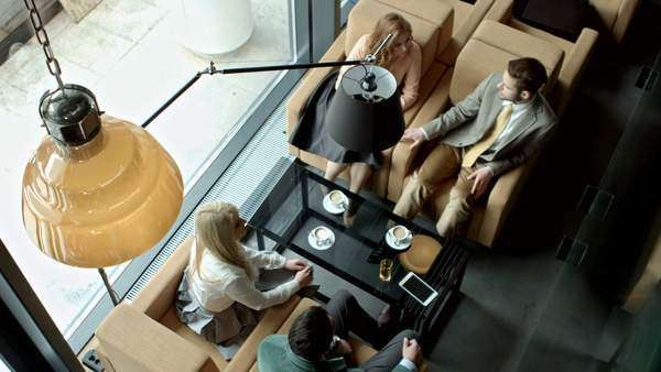 Group of business people having a chat at a café. Royalty-free stock video