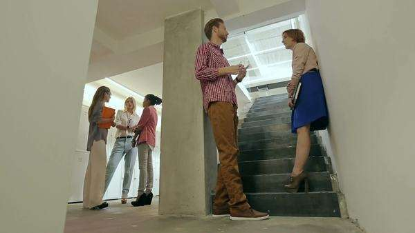 Groups of young business people talking in a company hallway. Royalty-free stock video