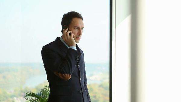 Caucasian businessman talking on the phone at his office. Royalty-free stock video