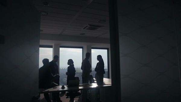 Silhouettes of business people in a meeting together. Royalty-free stock video