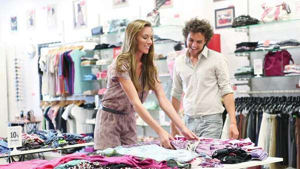 Young happy couple shopping together in a boutique. Royalty-free stock video
