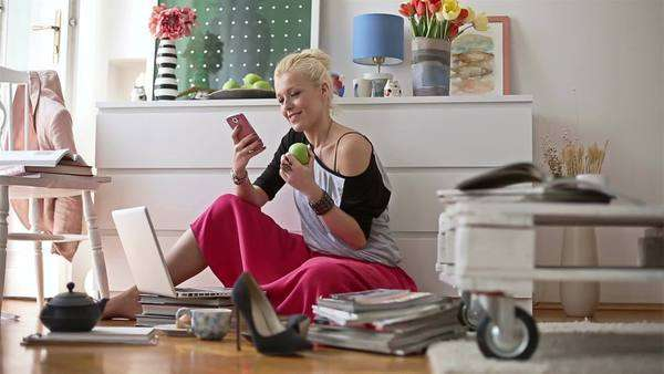 Smiling Woman Sitting on the Floor and Texting Royalty-free stock video