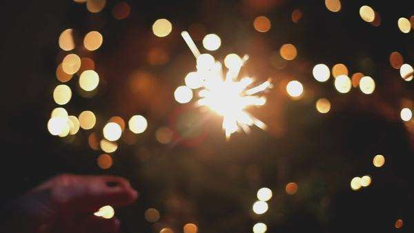 Hand of a woman lighting a sparkler at Christmas. Royalty-free stock video
