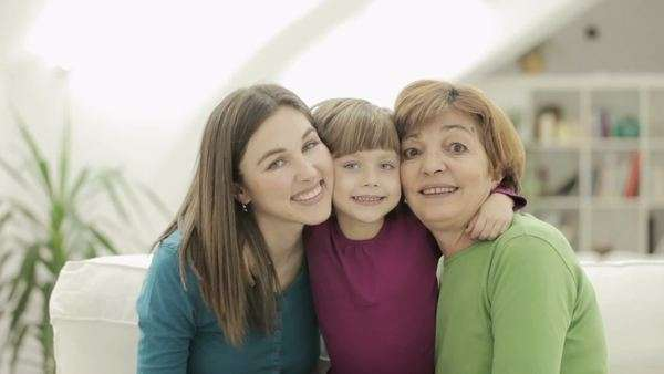 Portrait of three generations: mother, daughter, granddaughter. Royalty-free stock video
