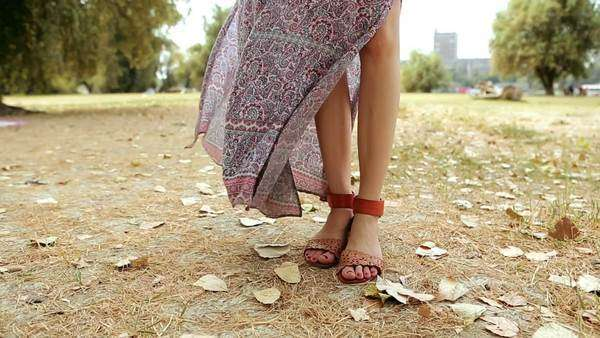 Feet of a woman wearing orange sandals. Royalty-free stock video