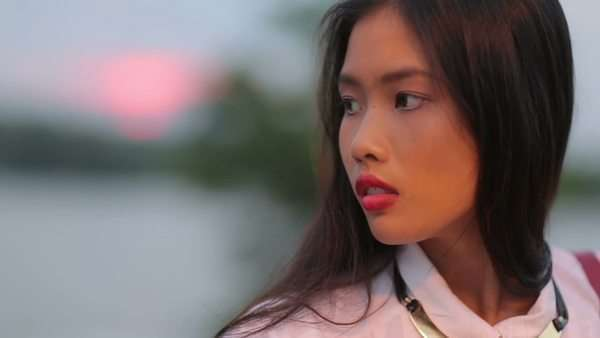 Outdoor portrait of a pretty young Asian woman. Royalty-free stock video