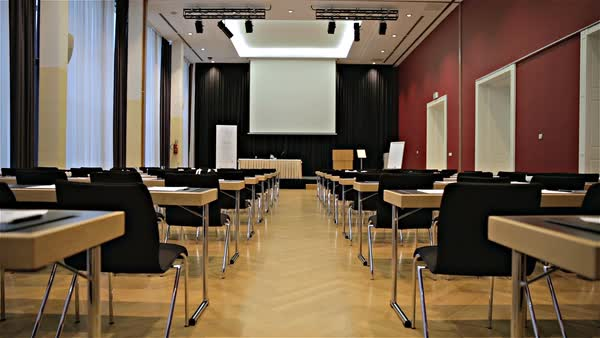 Big Conference Room With Projector Canvas From Behind Empty Seat - Big conference table