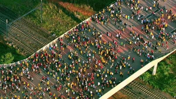 Aerial shot of a crowd of people entering FNB Stadium (Soccer City) Rights-managed stock video