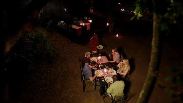 Top shot of a group of people eating dinner outside at night Rights-managed stock video