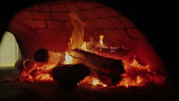 Close up of fire inside a pizza oven Rights-managed stock video