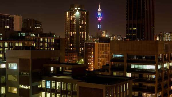 Static close-up timelapse at night of the Telkom tower with a view of the city centre of Johannesburg, South Africa Royalty-free stock video