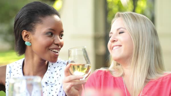Two woman drinking wine and laughing Royalty-free stock video