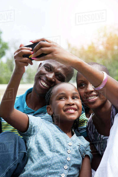 Girl taking selfie with her parents Royalty-free stock photo