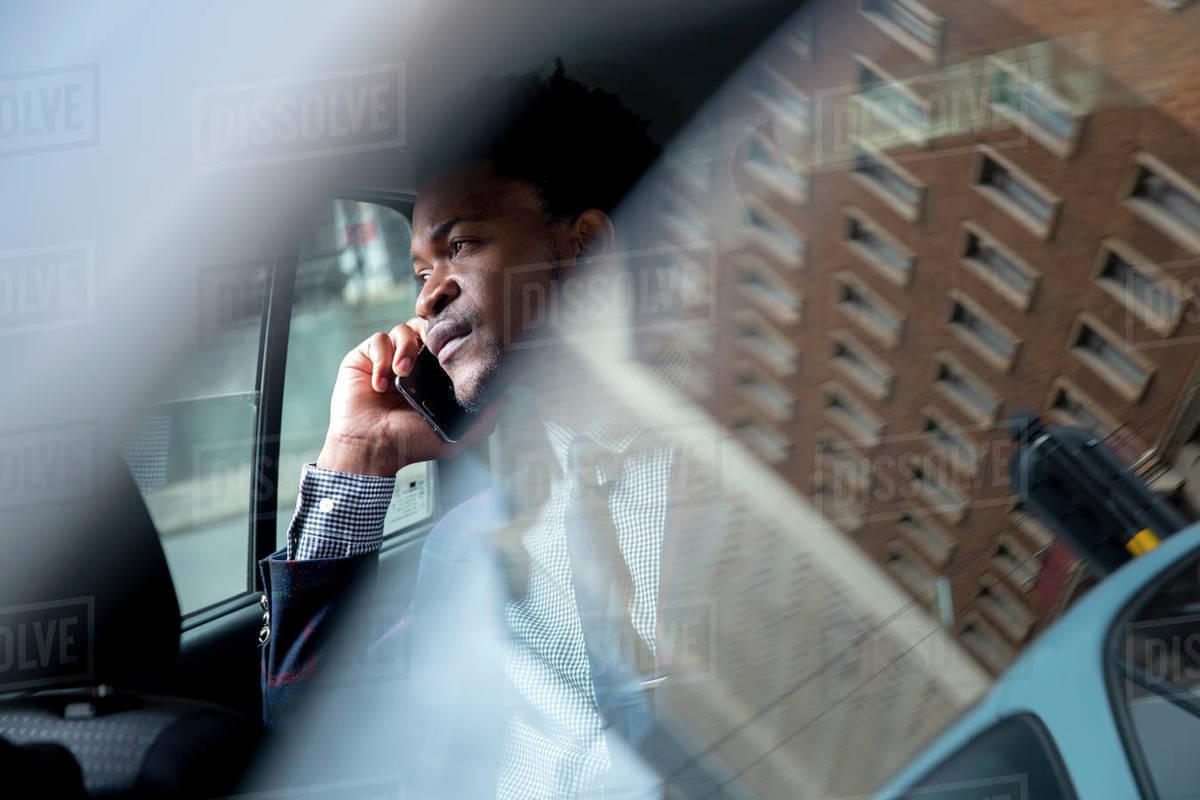 Business man seen through car window Royalty-free stock photo