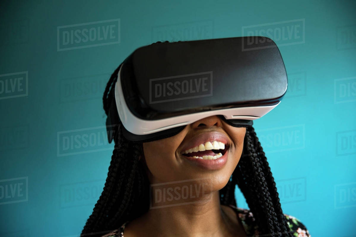 African man looking through VR headset stock photo