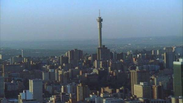 Aerial shot moving further away from the Johannesburg Central Business District at sunset/sunrise Rights-managed stock video