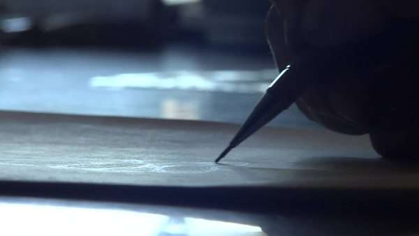 Close up of a hand sketching a design onto paper Rights-managed stock video
