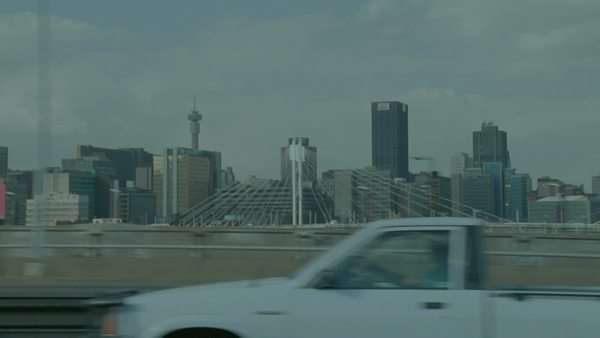 POV shot from a moving traveling on the highway passing Johannesburg CBD skyscrapers and the Nelson Mandela Bridge Rights-managed stock video