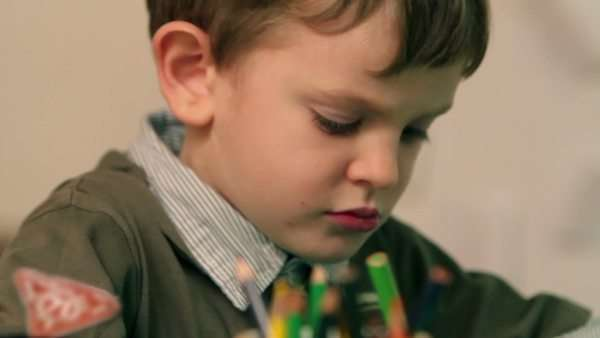 Close up on young kid drawing with green crayon Royalty-free stock video
