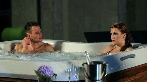 Young Romantic Couple In Jacuzzi Spending Time Together Royalty Free Stock Video