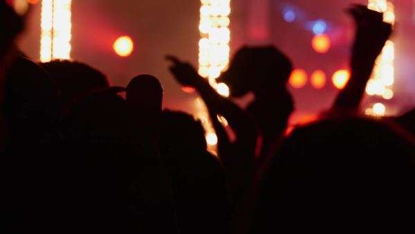 Medium close-up shot of people dancing at a concert Royalty-free stock video