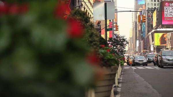 Pan right to a view of traffic passing on a busy street in New York City Royalty-free stock video
