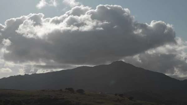 Storm clouds pass over a hilly area. Royalty-free stock video