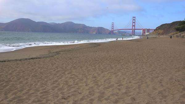 A view across Baker Beach in San Francisco to the Golden Gate Bridge. Royalty-free stock video