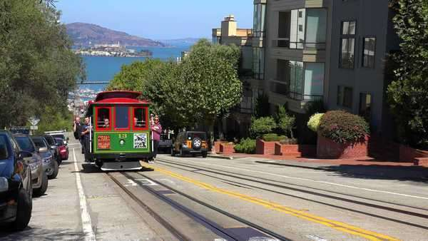 A cable car rises over a hill in San Francisco. Royalty-free stock video